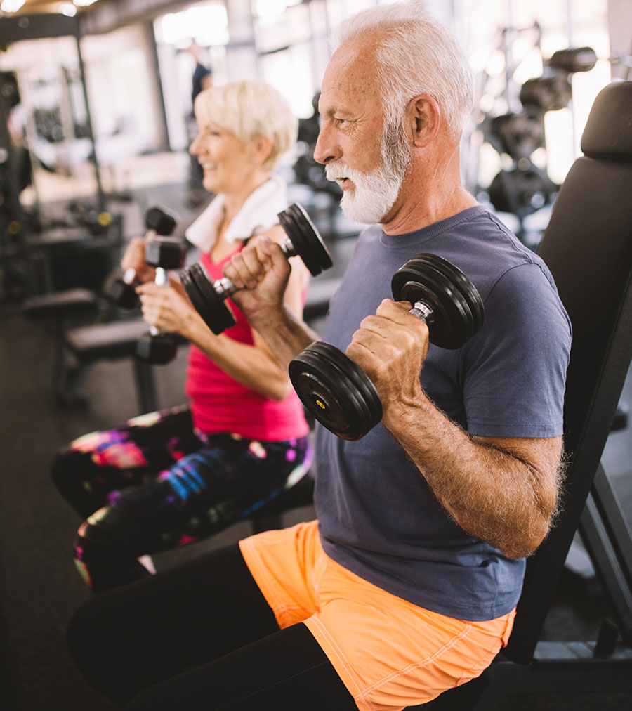 Senior man and woman working out
