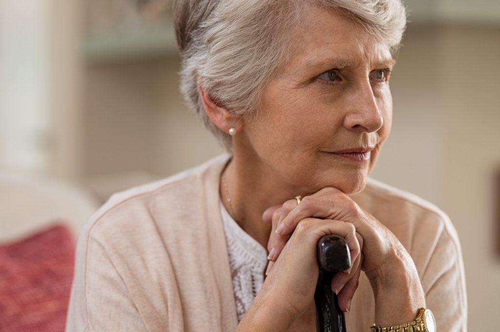 Senior woman holding cane